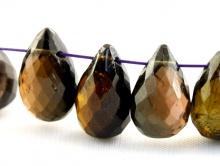 Камень натуральный-турмалин, бусина огранённая форма-бриолет цвет-янтарно-зеленый, темный, с бурым оттенком,