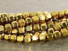 Бусины-гематит натуральный тонированный ограненный. Форма-шестигранник. Цвет-золотистый (античное золото).