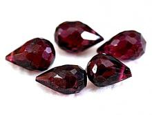 Камень-Гранат красный (альмандин) ограненный.
