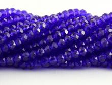 Рондели мелкие-бусины стеклянные огранённые, цвет бусин-прозрачный синий с фиолетовым оттенком