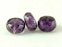 Камень-александрит (иск. выращенный), ограненный, форма бусины рондель ручной огранки.