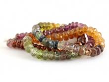 Нить бусин огранённых ронделей из камня-гранат натуральный, цвет-микс: три цвета разной тональности-красно-вишнёвый, красно-золотистый и серо-зелёный.