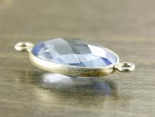 Коннектор серебряный с огранённой вставкой из голубой шпинели (иск. выращенной).