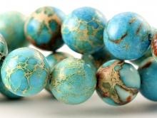 Бусина круглая-камень варисцит, натуральный природный тонированный. Диаметр - 12 мм. Цвет теплый-голубой.