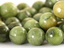 Бусина круглая, гладкая, натуральный камень-нефрит (уральский), диаметр–10+-0,1 мм., цвет-зелёный с редкими чёрными включениями