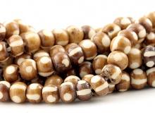 Бусины-распорки, материал-кость натуральная тонированная, форма-рондель, цвет основной-бежевый с белым.