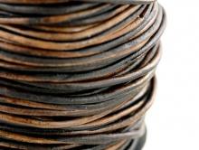 Кожаный шнур круглый 1.5 мм., цвет темно-коричневый, (неоднородный 3 тона).