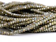 Рондели мелкие-бусины стеклянные огранённые, размер: 2,5х1.6 мм. (+- 0,1 мм.). вн.отв. 0,5 мм. Цвет бусин-коричнево-бежевый, непрозрачный с радужным переливом,