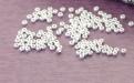 Бусины матовые посеребрёные-японский бисер 1.5 мм. внутренне отверстие 0.6 мм. Цвет-белое серебро.