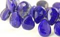 Бусина–ограненная формы удлинённого лепестка, камень-лазурит натуральный, цвет-сочный синий с природными включениями пирита,