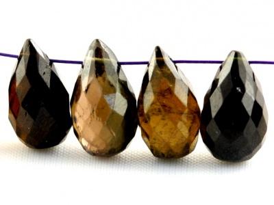 Камень натуральный-турмалин, бусина цвет-янтарно-зеленый, темный, с бурым оттенком,