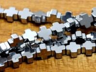 Бусиныформа бусин-крестик. камень-гематит натуральный, цвет-серебро с металлическим блеском.