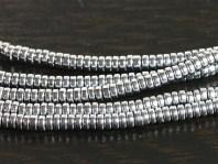 Бусины мелкие 2х1 мм. распорки форма - шайбочка, камень–гематит натуральный, цвет-серый с серебристымметаллическим блеском,