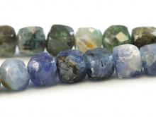 Нить бусин огранённых кубиков. Камень-кианит натуральный, форма бусин-кубик огранённый.Цвет-микс синий, голубой по2-3 тона каждого,