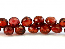 Камень-гранат натуральный, огранка ручная, форма луковка, цвет-красно-коричневый с золотистым оттенком,