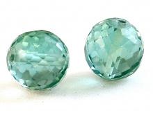 Бусина круглая огранённая, искусственно выращенный камень - шпинель благородная, цвет-холодный зелёный, прозрачный.