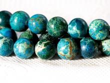 Бусина-шарик гладкий, камень варисцит натуральный, тонирован в теплый сине-голубой.Размер-8.5мм.