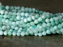 Нить бусин шариков 3 мм, бусины ограненые-камень натуральныйамазонит. Цвет-нежный салатово-голубой (2 тона) Размер-3 мм.