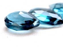 топаз голубой, ф. лепесток ограненный 8-8.5х6.5х3.5 мм.