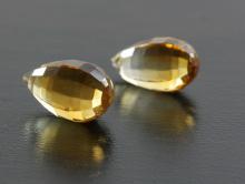 Камень-цитрин натуральный, бусина ручной огранки, форма бриолет. Цвет-золотистый, сочный, чистый.