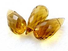 Бриолет-бусинакапля удлиненная, тонкая, ручной огранки. Класс премиум -топаз золотистый натуральный камень.