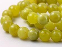 Бусины форма шарик, камень-нефрит  натуральный, цвет-зеленый теплый, с редкими едва заметными чёрными включениями.
