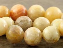 Больше средних, бусины круглые красивой кремовой окраски, диаметр–12 (+-0,2) мм. вн. отв. 1.4 мм.