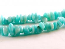 Бусины-крошка гладкая, камень амазонитнатуральный, Цвет-бирюзово-голубой теплый, неоднородный.Размер; ширина по нити-от 5 до 10 мм.