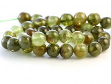 Бусина из натурального камня:гроссуляр -зеленый гранат, полупрозрачный, ближе к прозрачному,