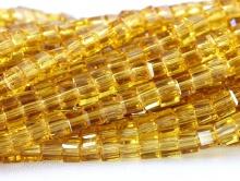 Бусина стеклянная, мелкий кубик 2.5 мм. с лёгкой огранкой, цвет бусин: прозрачный янтарно-золотой.