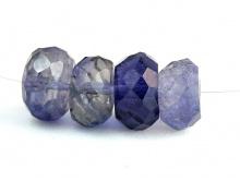 Бусина ограненная форма рондель.Камень натуральный-иолит, цвет-сине-фиолетовый, с бурым (в зависимости от угла зрения).