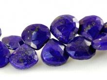 Бусина–ограненная формы широкого лепестка, камень-лазурит натуральный, цвет-сочный синий с природными включениями пирита,