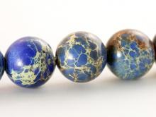 Бусина круглая гладкая, камень варисцит натуральный, синий тонирован. Цвет-синий, с лёгким фиолетовым оттенком.
