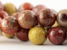 Бусины круглые огранённые из натурального камня–яшма мукаит, цвета-основные: кирпичный и горчично-жёлтый, размер-12 мм.