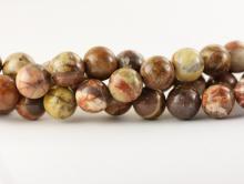 Бусины из натуральной яшмы, круглые пестрой окраски, диаметр–10 мм. Цвета-основные: коричневый, бежевый, серый, терракотовый.