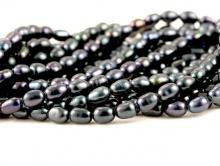 Товар–жемчуг радужный натуральный, гладкий, цвет-черный с лёгким зеленоватым оттенком, размер-5х3 (+-0,3) мм.,