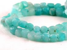 Камень-амазонит натуральный, форма бусин-кубик огранённый.Цвет-теплый голубой неоднородный,