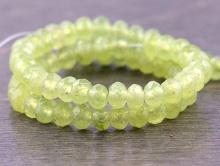Камень-хризолит натуральный, форма бусины -огранённая рондель, цвет-зеленый полупрозрачный