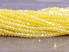 Рондели самые мелкие-бусины огранённые стеклянные, цвет бусин-прозрачный жёлтый с лёгким переливом,