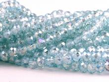 Рондели-бусины стеклянные огранённые, мелкие, размер 4.5х3,3 мм. Цвет бусин-прозрачный тёплый голубой, с лёгким золотистым переливом
