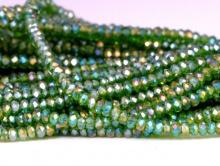 Рондели мелкие-бусины стеклянные огранённые, размер: 2,5х1.6 мм. (+- 0,1 мм.). вн.отв. 0,5 мм. Цвет бусин-прозрачный, тёплый зелёный, с радужным переливом
