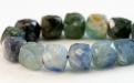 Нить бусин огранённых кубиков. Камень-кианит натуральный, форма бусин-кубик огранённый.