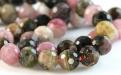 Нить бусин огранённых. Камень-турмалин натуральный, форма бусин-шарик огранённый.Цвет-микс: розовый, зелёный, медовый по2-3 тона каждого,
