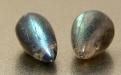 Камень натуральный лабрадор, отполированный. Цвет-серый с зелено-голубым и желтовато-зеленымпереливом на каждом бриолете.
