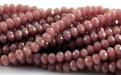 Бусины стеклянные мелкие, рондели огранённые, цвет бусин-непрозрачный розовато-серо-коричневый матовый, размер 3х2 мм.