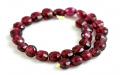 Камень-гранат натуральный (пироп), форма бусин-таблетка огранённая.Цвет-красно-вишневый (ближе к цвету перезревшей вишни), прозрачный.