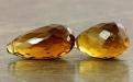 -бусина формы огранённой капли ручной огранки (бриолет больше среднего удлинённый). Камень-топаз золотистый натуральный природный.