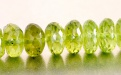 Бусина-рондель  огранённая, камень- натуральный хризолит, цвет-зеленый яркий, чистый (весенней зелени), размер: ш/в-7,5х3.5 мм.
