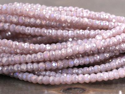 Стеклянные мелкие-бусины, рондели огранённые, размер: 2.5х1.8 мм. (+- 0,1 мм.). вн.отверстие 0,5 мм., цвет бусин-прозрачный розовато-сиреневый